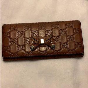 Damage Disclosure - Gucci Wallet